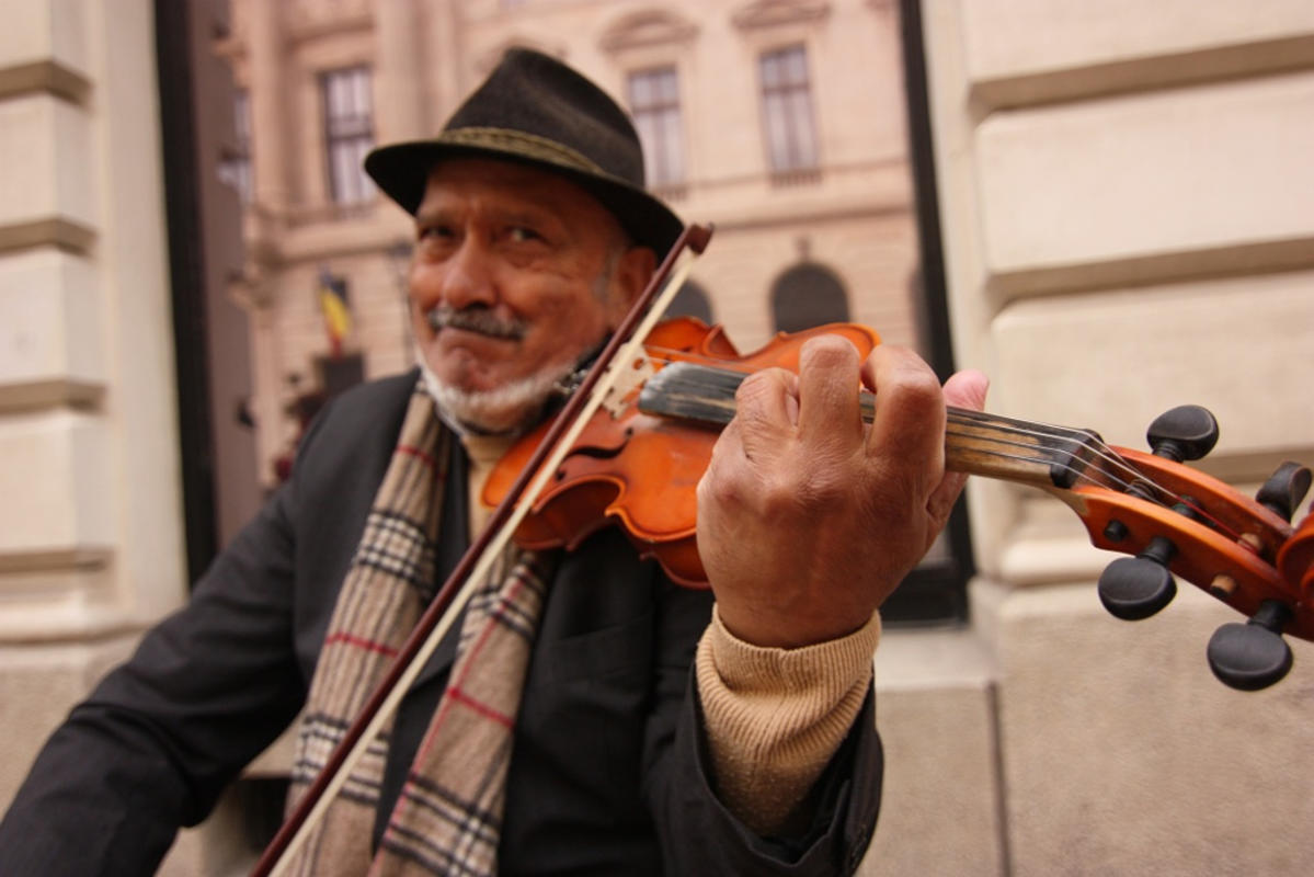 Violin player by Nicu Buculei via Flickr Creative Commons