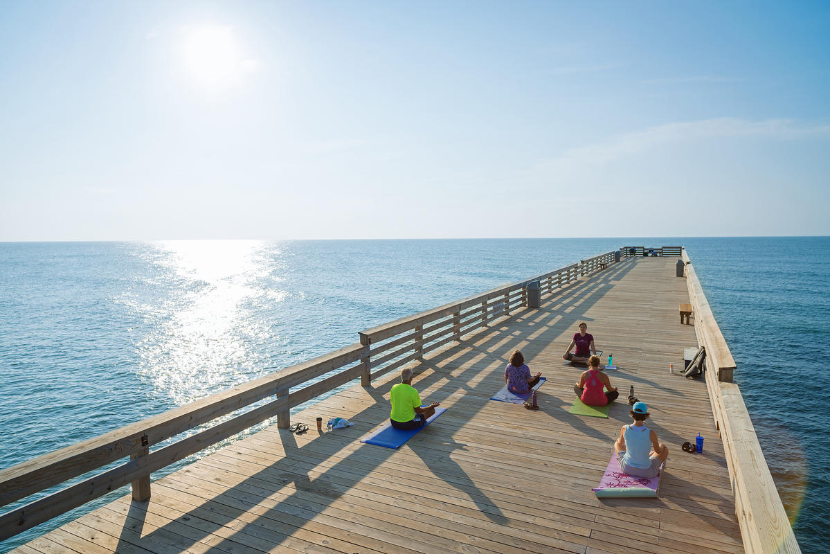 Wrightsville Beach Pier Yoga by Wilmington and Beaches Convention & Visitors Bureau