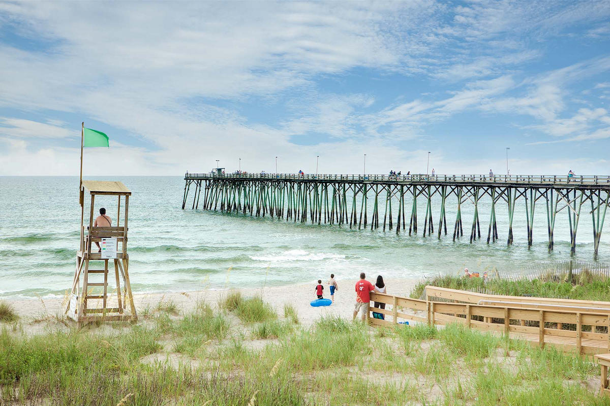 Kure Beach Ocean Front with Pier Photo by Wilmington and Beaches Convention & Visitors Bureau
