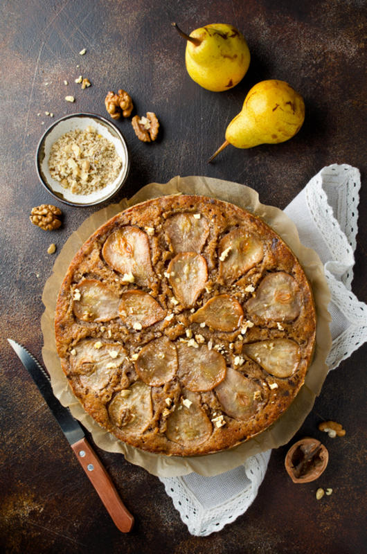 Pear pie with walnuts and chocolate chips on old stone background, fruits © iStock / vkuslandia