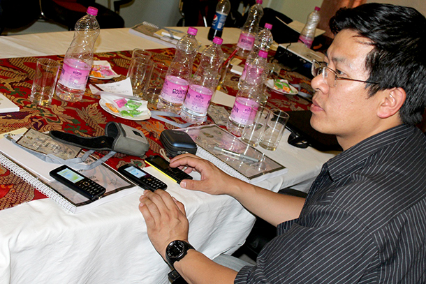 Sonam Wnagdi is checking the seized phones for further contacts and checking