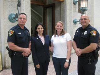 The author and IFAW's Kelly Donithan stand with two first responders ready to protect the big cats!