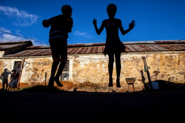Children skip in Durban Deep on the outskirts of Johannesburg, South Africa.