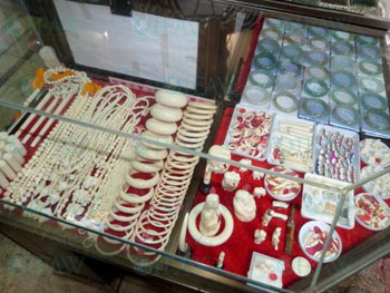 Trinkets and carvings made from ivory are among the items to avoid when purchasing souvenirs abroad.