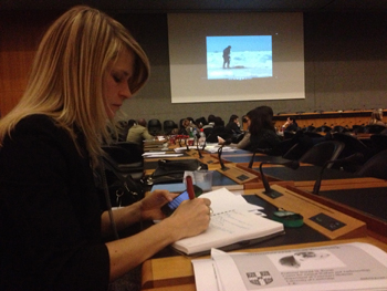 IFAW's Sheryl Fink taking notes from the World Trade Organisation meeting in Geneva.