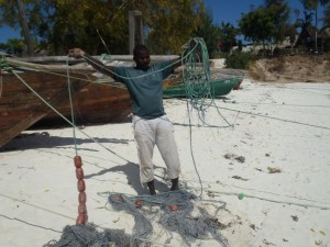 Khamis with net broken from whale entanglement.