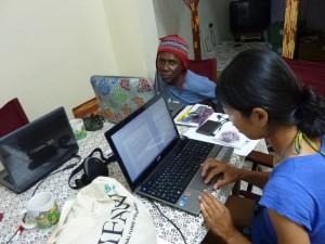 Mwalimo and Kristin writing blogs
