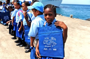 A Floating Classrooms student holds her new reusable shopping bag.
