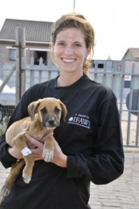 The author and IFAW Mdzananda volunteer with a puppy in South Africa.