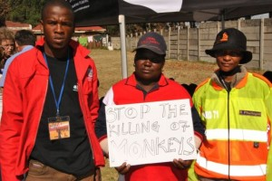 Siyabonga and two of the community patrollers who assist with the programme.