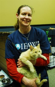 Danielle with one of the cats she rescued.