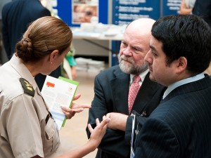 IFAW CEO Fred O'Regan speaks with delegates at the 2010 INTERPOL conference in Lyon, France.