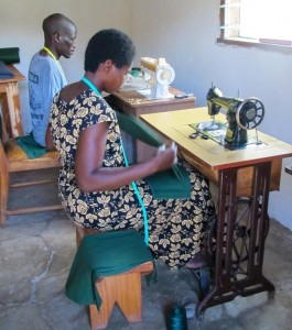 Two tailors working on Liwonde National Park rangers uniforms.