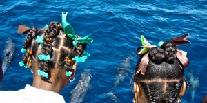 Two IFAW Floating Classrooom students marvel at dolphins off the coast of Dominica.