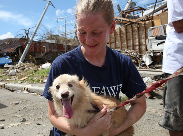The author in Tacloban after Typhoon Haiyan with 'Sweetie' the dog.
