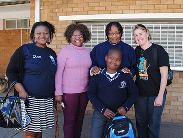 Kganya with his award and, from left to right, Nthabiseng Raditapole (Education Officer at CLAW), Kganya's Mom, his teacher, and the author