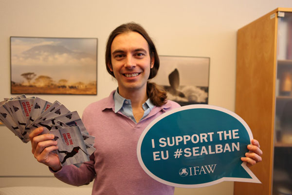 MEP Kriton Arsenis (S&D Group) shows his support and accepts postcards from concerned IFAW supporters from across Europe.