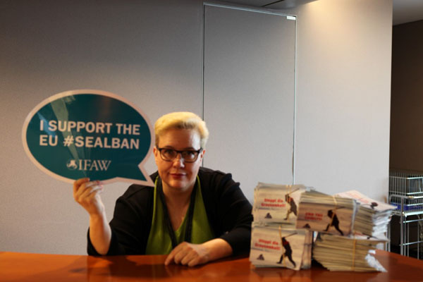 MEP Sirpa Pietikainen (EPP Group) shows her support for the EU seal ban with a small sample of IFAW supporter postcards.