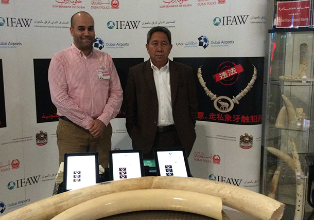 Syafri Adnan Baharuddin (right), Indonesian Ambassador to the United Nations to the WTO, poses with Ahmad Abouzahra, IFAW Dubai campaigns assistant, to show his support for the IFAW campaign.