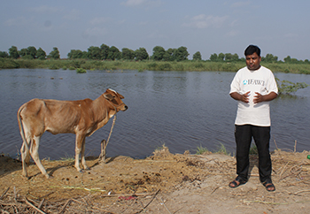 Ravi Foundation Executive Director, Mr. Ashfaq Fateh with friend. c. IFAW