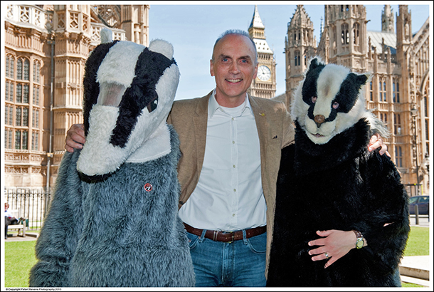 Chris Williamson MP (centre) pictured with costumed campaigners opposing the badger cull.