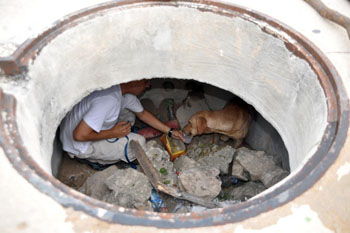 "Down in a sewer hole, the author gives ""Kaab"" a bit of water."