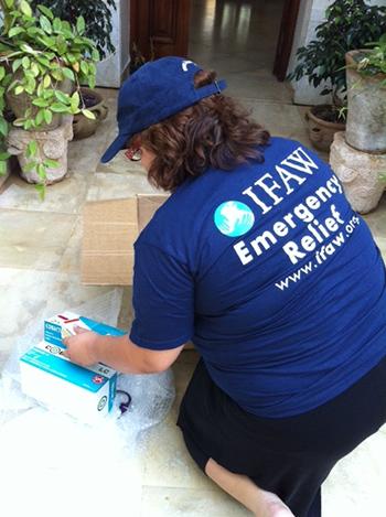 IFAW's Dr.RymZakhama packing medicines.