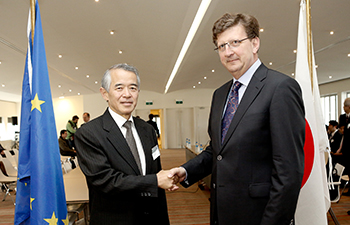 "Handshake between Mauro Petriccione, Director for ""Development and management of trade relations with Neighbourhood Countries and with South-East Asia at the DG Trade of the European Commission, and Jun Yokota, Japanese Chief Negotiator, Special Representative of the Government in charge of the Japan-EU EPA negotiations on April 15, 2013. c. European Union 2013."