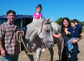 A thankful family in Colorado with their healthy horse.