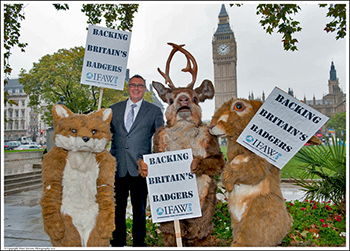 IFAW UK Director Robbie Marsland with some representative animal friends during IFAW's recent on-site Parliamentary action where some 300 supporters came out.