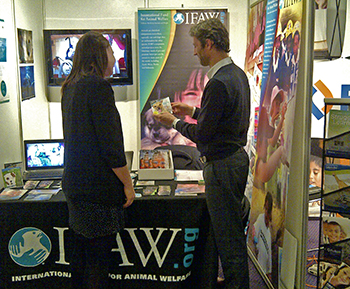 The author (right) with a visitor to the IFAW stand at the RAI Amsterdam.