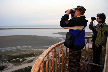 Members of the IFAW Russia Western Grey Whale research team on the island lighthouse balcony.