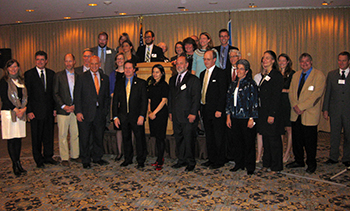 "Attendees pose for a photo at the ""A Wild Success: Forty years of the Endangered Species Act"" gathering."