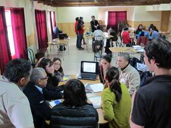 HCD facilitators discuss community data with workshop participants.