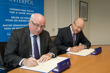 IFAW President and CEO Azzedine Downes with Interpol's Executive Director of Police Services, Jean-Michel Louboutin signing an MoU at Interpol's headquarters in Lyon, France yesterday.