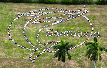 "On the eve of the IWC meeting, hundreds gather in Panama to call for South Atlantic Whale Sanctuary (July 1, 2012 Panama City, Panama) Hundreds of Panamanians and members of the International Community gathered along the Panama Canal and formed a giant human whale with the message ""Santuario"" (sanctuary) to call for the creation of the Southern Atlantic Whale Sanctuary on the eve of the 64th annual meeting of the International Whaling Commission (IWC) being held in Panama City as part of the Save the Whales Again! Campaign.  ©Jeff Pantukhoff/Spectral Q/Whaleman Foundation  Sponsors: Almanaque Azul, Ciudad del Saber, Fudacion Albatross Media, IFAW, GREENPEACE, TVN, and The Whaleman Foundation."