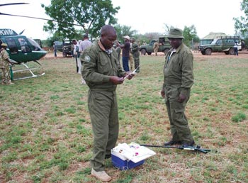 Dr Jeremiah Poghon, a vet with Kenya Wildlife Service (KWS) prepares darts with the opiate used to immobilise elephants while Dr David Ndeereh looks on.
