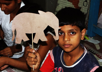 One of the children with his wood-craft elephant.