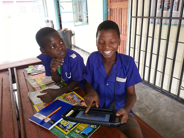 Two learners in Nanthomba were very interested in how an iPad works.