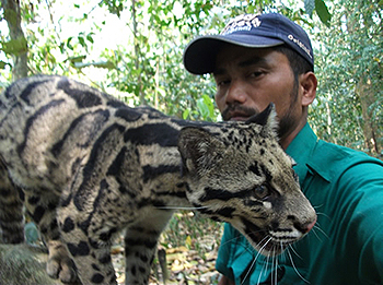 Ontai with a clouded leopard. Photo credit: IFAW-WTI