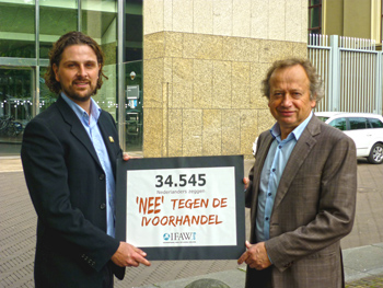 Riekkert Reijnen, Dutch Campaign Officer for IFAW Netherlands hands the Dutch Secretary of State on Environment Mr Hans Bleker our supporter's petition signatures.