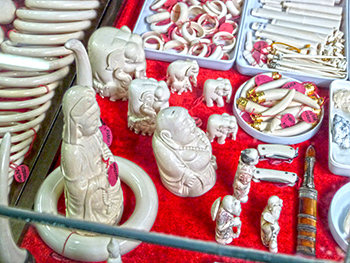 Ivory carvings on a market in Tachilek, Myanmar
