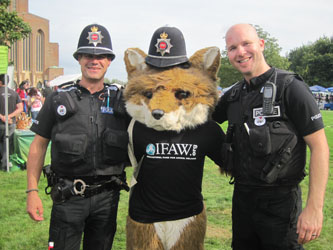 UK law enforcement during a moment of levity with IFAW's Freddie the Fox.