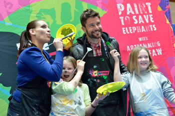 Two participants with local celebrities who gave of their time at the paintathon. Copyright:  Trevor Samson