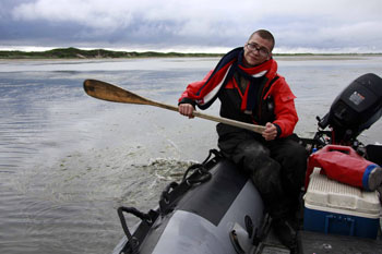 A member of the IFAW Russia Western Grey Whale Research team paddles along.