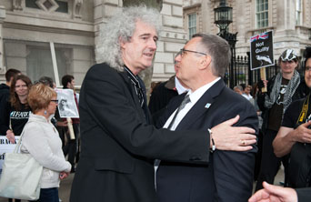 IFAW UK Director Robbie Marsland and Dr. Brian May outside Downing Street after handing over anti-badger cull petition counts. c. IFAW