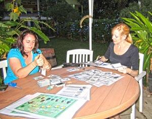 Kara and Amanda preparing educational resource materials for the teachers.