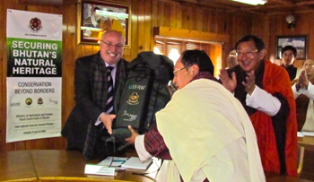 The author hands over anti-poaching field kits to Karma Dukpa (left), Director General, DoFPS, MoAF, Bhutan. Photo - Radhika Bhagat