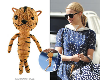 """Titius the Tiger hangs with """"Glee"""" star Dianna Argon. Image source Fashion of Glee."""