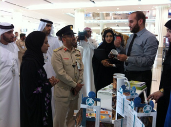 Booth staff and officials at the Dubai International Airport booth.